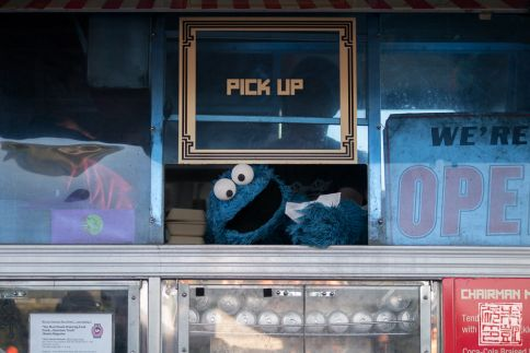 Cookie Monster serving Chairman Bao